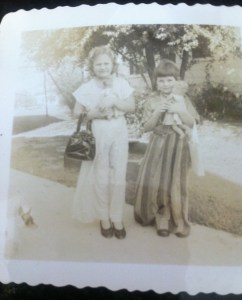 The author at age four and her older, taller neighbor also dressed up
