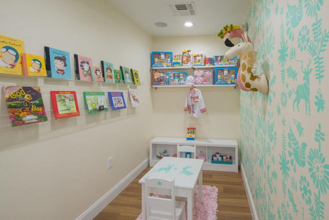 Bambinos' playroom and book display in their new San Antonio location (Kody Melton, photographer)
