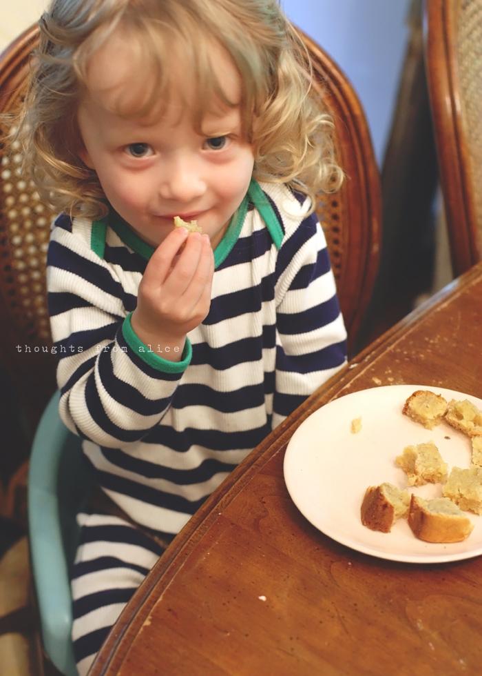 child enjoying banana bread made from scratch