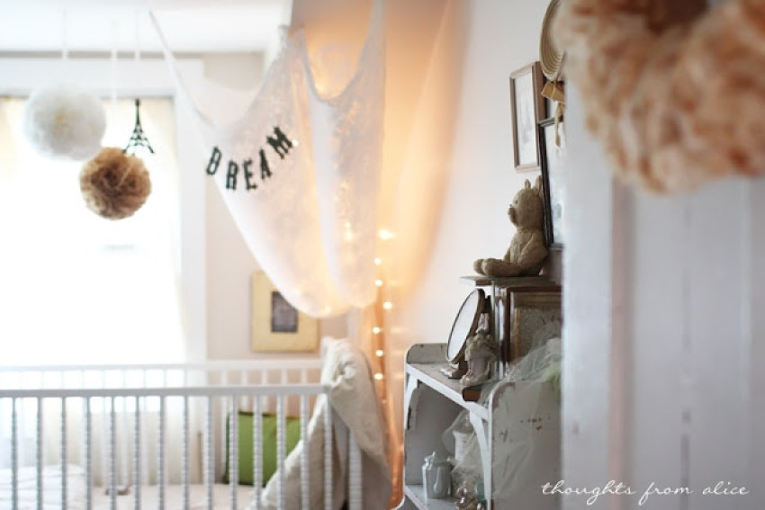 baby girl nursery withvintage inspired neutral decor