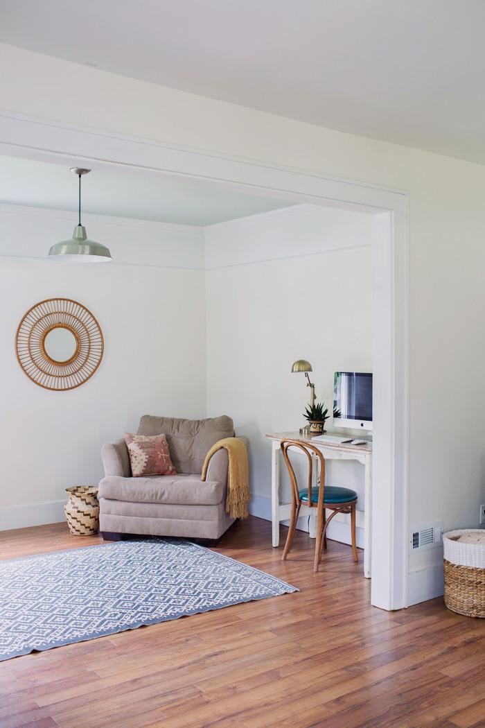 Simple boho home office in multipurpose room