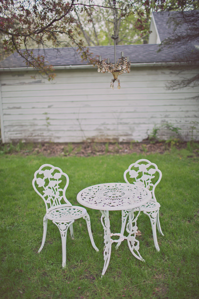 Backyard decorating with white garden patio set and chandelier