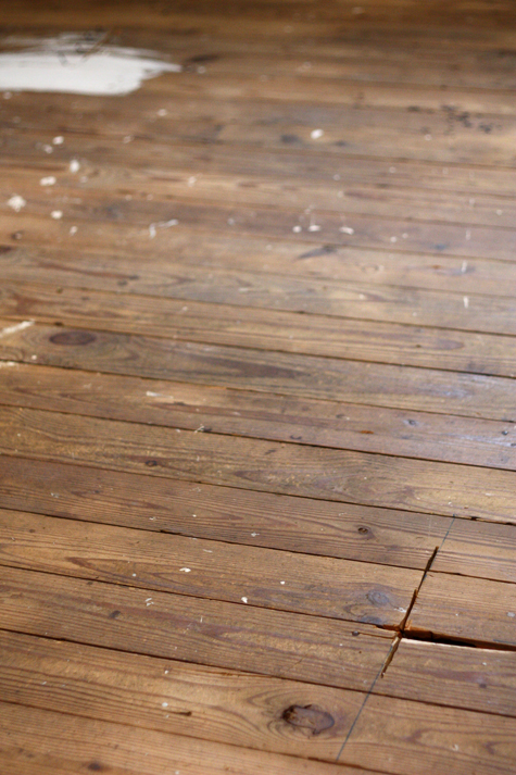 Rough pine floors in older home before being redone
