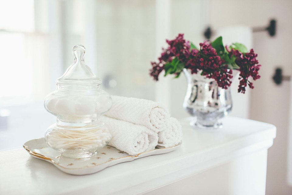 Updating a Bathroom with Fresh Linens and Flowers