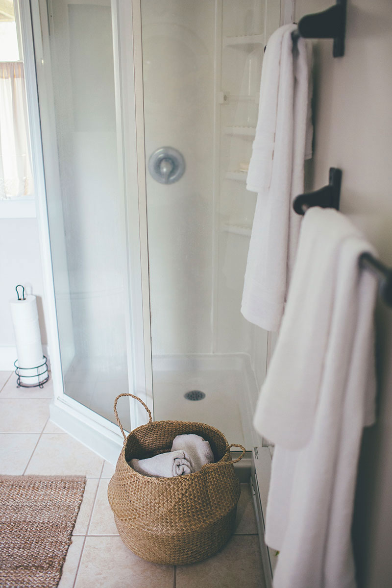 Matching White Towels and Towel Storage in Bath