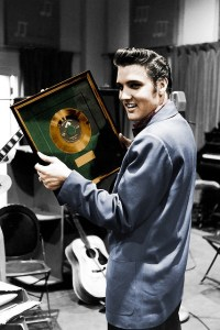Elvis with gold record