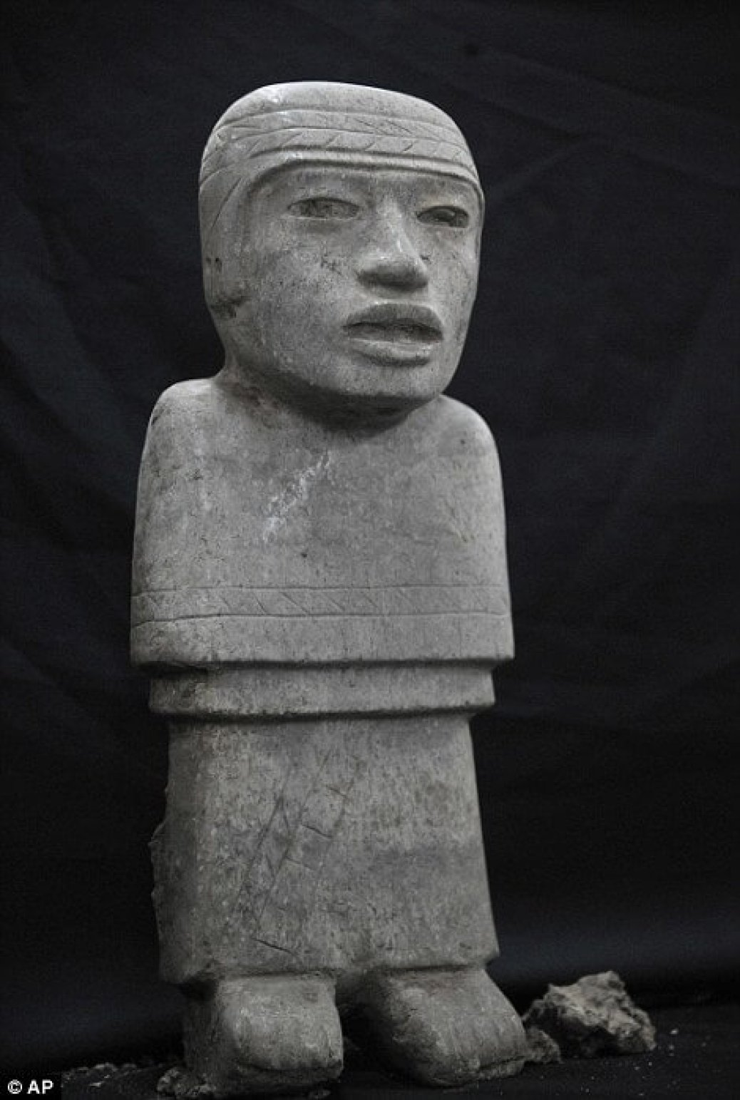 """Handout picture released by the National Institute of Anthropology and History (INAH in Spanish) showing a stone sculpture found at the Temple of the Feathered Serpent (Serpiente Emplumada) at the Teotihuacan complex in Mexico City, taken on October 25, 2014. Archaeologist Sergio Gomez announced in a press conference in Mexico City on October 29, 2014 that new discoveries were made recently at the temple. The discovered offering is located at 103 metres from the entrance of the temple and contains thousands of items including 4 stone sculptures and jade ornaments. AFP PHOTO/INAH --- RESTRICTED TO EDITORIAL USE - MANDATORY CREDIT """"AFP PHOTO /INAH"""" - NO MARKETING NO ADVERTISING CAMPAIGNS - DISTRIBUTED AS A SERVICE TO CLIENTS--/AFP/Getty Images"""
