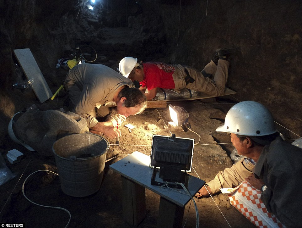 National Institute of Anthropology and History (INAH) archaeologists work at a tunnel that may lead to a royal tombs discovered at the ancient city of Teotihuacan