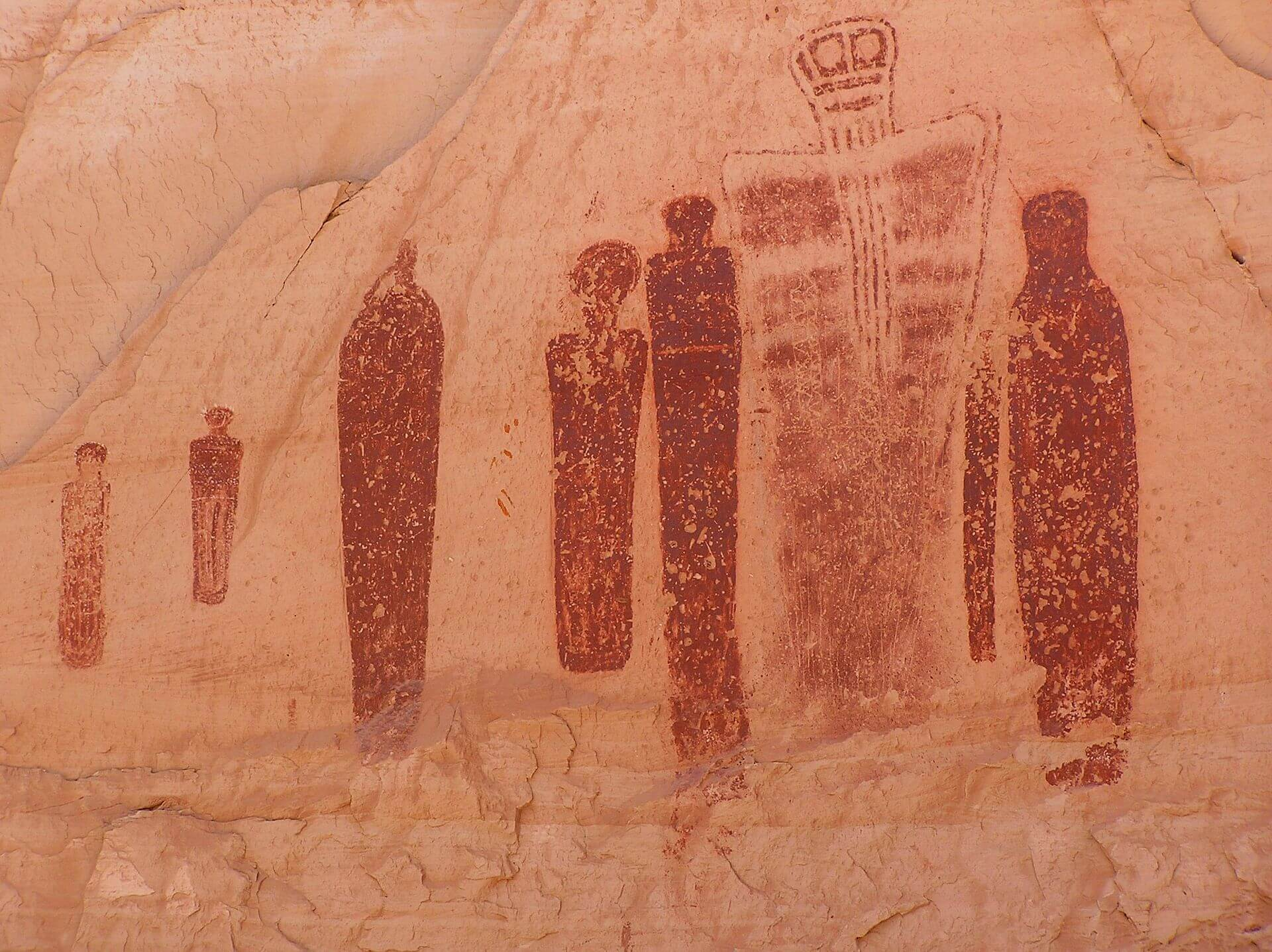 This portion of the Great Gallery, found in Horseshoe Canyon, is an example of a Barrier Canyon Style pictograph (painted rock art). The full panel is 200 feet long, 15 feet high and the paintings are life-sized human figures. The largest figure pictured is about 7 feet tall. Horseshoe Canyon, also known as Barrier Canyon, is a detached part of Canyonlands National Park in Utah, west of the Green River, and north of the National Park's Maze unit. (Image via wikimedia commons user Scott Catron, used under a CC BY-SA 3.0 license.)
