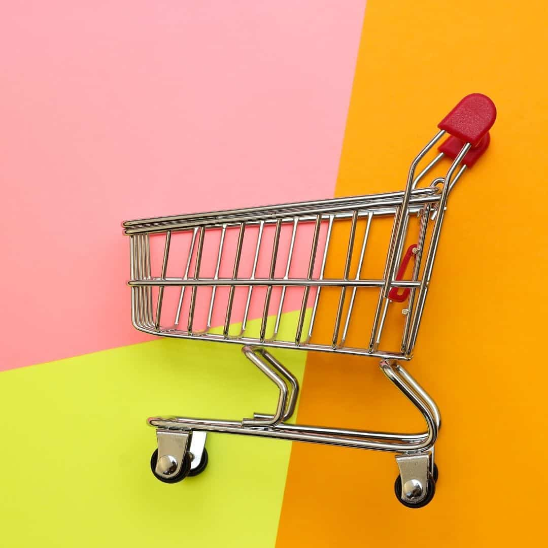 photo of a shopping trolley on a bright coloured background - aldi shopping tips