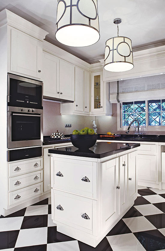 Transitional Styled Kitchen with White Molding, Black Granite and Checkerboard Flooring by Megan Perry Yorgancioglu