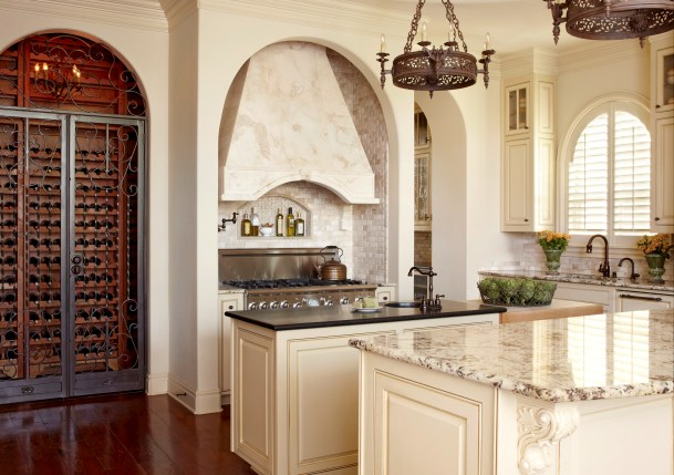Two Island Kitchen with Two Unique Granite & One Chopping Block Countertop Surface. Wine Cellar Equipped with Dual Temperature Zones by Susan Brechtel