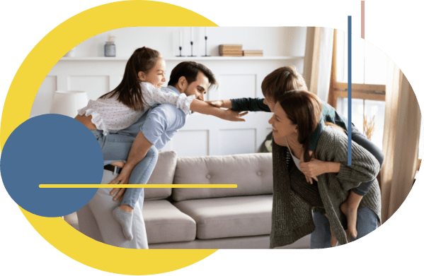 Two co-parents who have moved through the impasses in their relationship are sharing a dance in the living room with their daughter.
