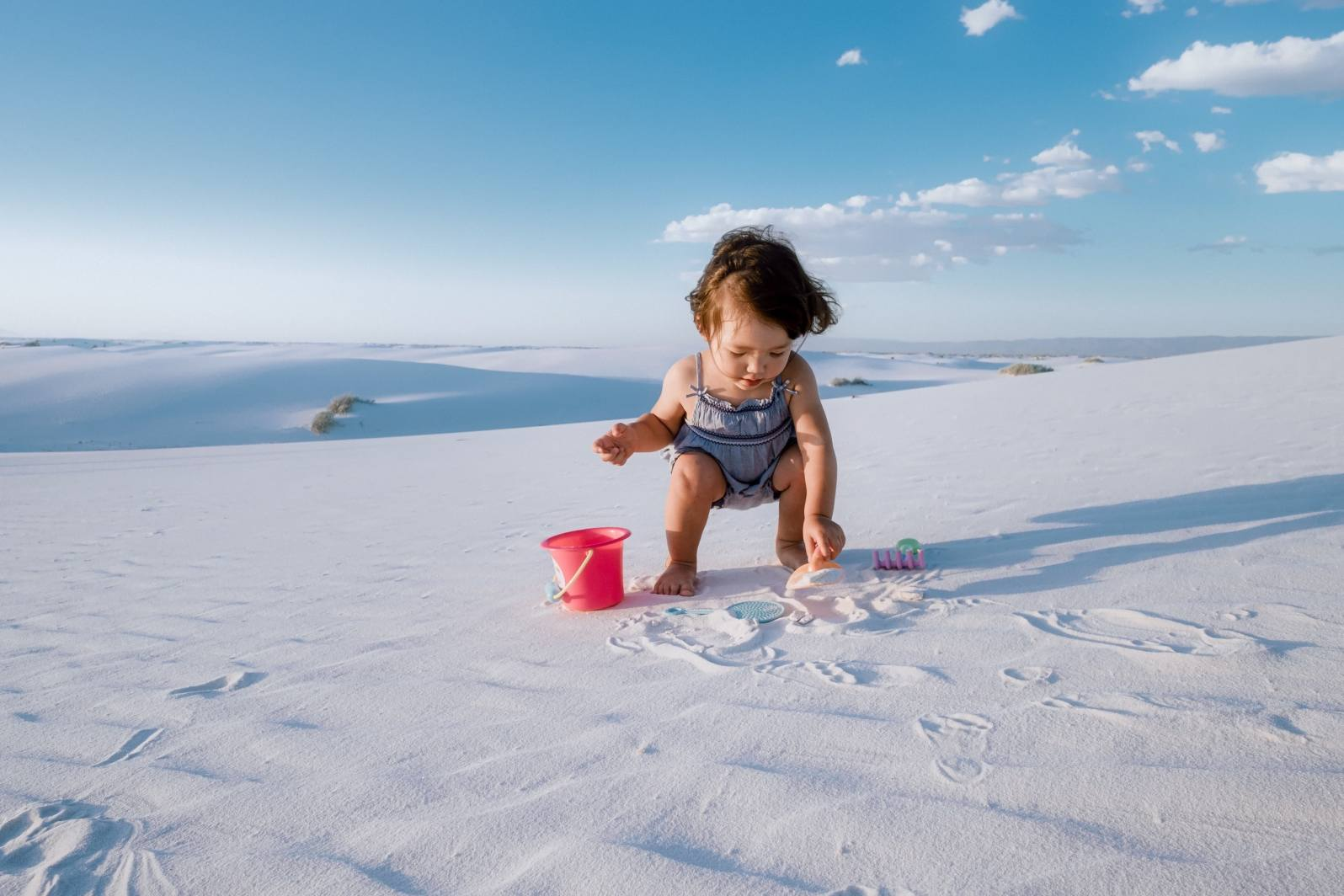 Kalina playing in the sand at White Sands New Mexico.