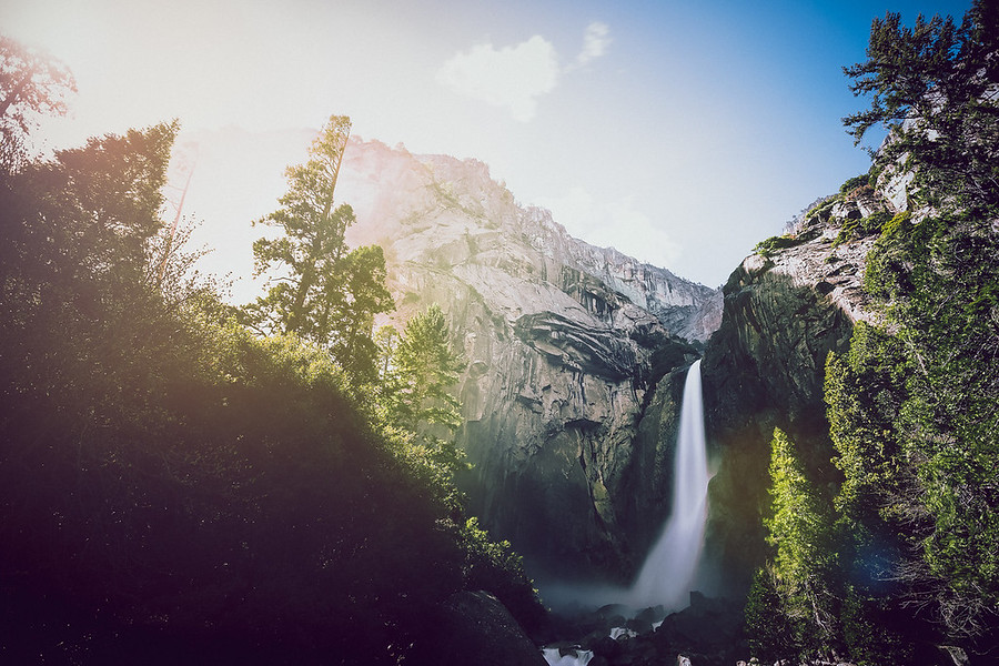 Sun Flares at Yosemite Falls You don't realize it until you're there but the falls this time of year give off so much mist, while standing there watching them you slowly find yourself getting wet. Shooting the falls is like the grown up version of being a kid and running through the sprinklers.