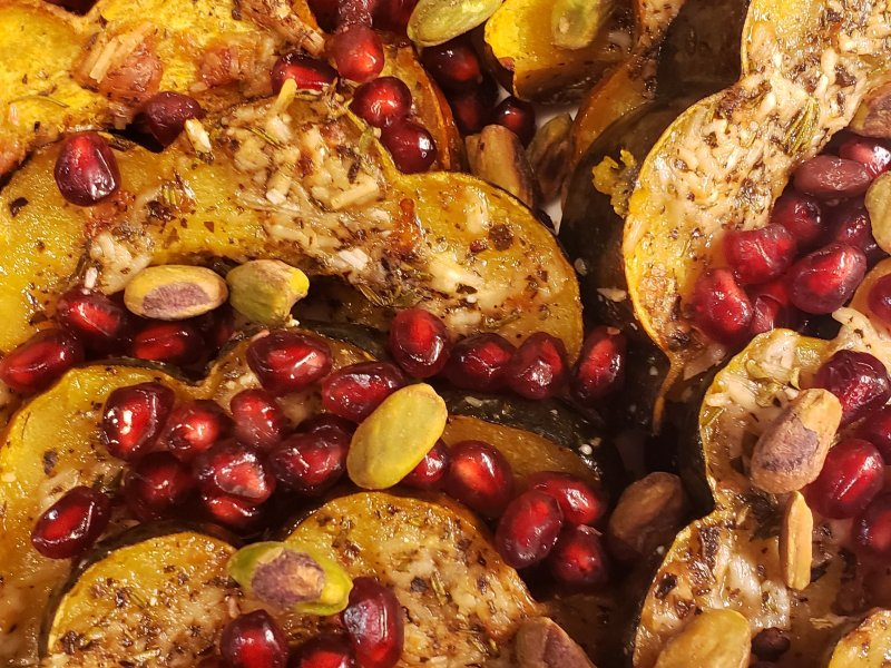 Herb Roasted Acorn Squash with Pomegranates and Pistachios