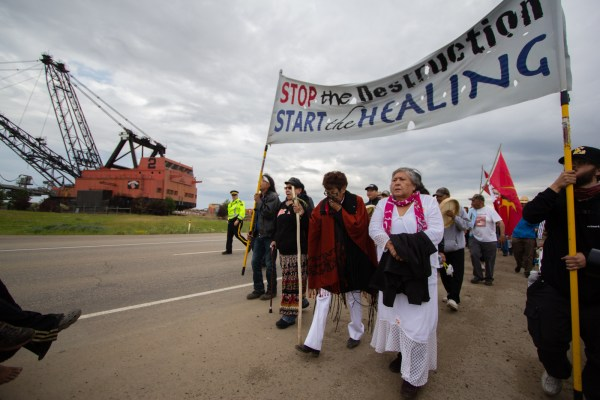Elders lead the fourth annual Healing Walk around twenty-five kilometres of toxic industry encroaching on First Nations' traditional territory, 2013. Photo Credit: Ben Powless