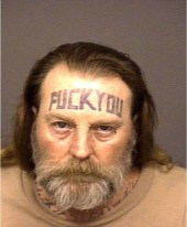I'm guessing that this guy doesn't get a lot of call-backs after job interviews. Picture source: http://www.tattoobite.com/tattoos/forehead-tattoos/page/10/.