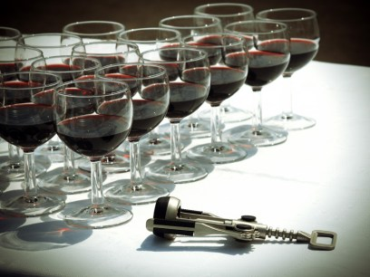 Wineglasses with red wine and the corkscrew
