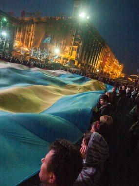 People hold flags of Ukraine and Crimea stitched together