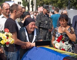 The mother and relatives of the died soldier