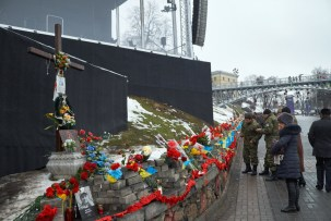 Wall of Remembrance at Instytutska street. A pedestrian bridge and Zhovtnevy palats (October palace) on the background.