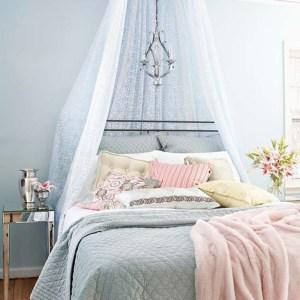 Feminine-Bedroom-Design-In-Light-Blue-with-blue-curtain-design-ideas-with-flower-decoration-design-ideas