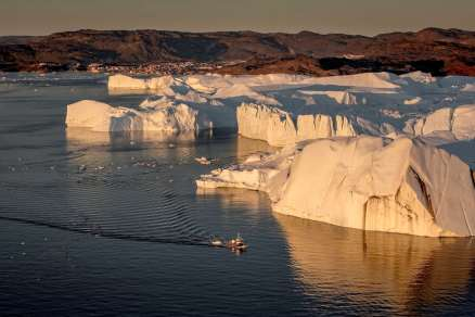 a-fishing-vessel-near-the-ilulissat-ice-fjord-in-greenland-with-ilulissat-in-the-background