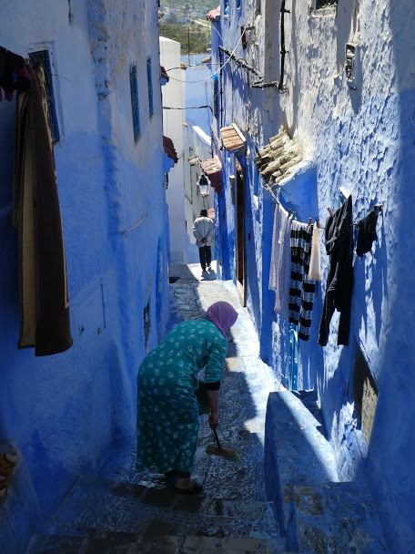 Sweeping the steps in Chefchaouen Medina
