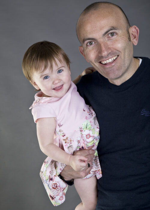 daughter and father photo on grey background in hull studio