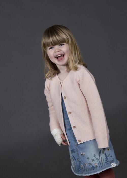 Studio portrait of young girl on grey background