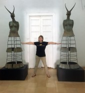 Leanna Staines, Volunteer Coordinator, with sculptures by Melva Medina
