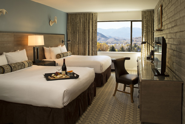 A renovated bedroom at the Snow King Resort with stunning views of the Tetons