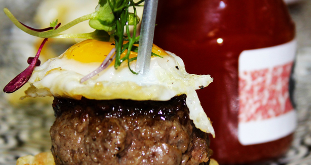 This is the Prized Wagyu BQT: Wagyu Chuck Burger, Quail Egg, Truffles.