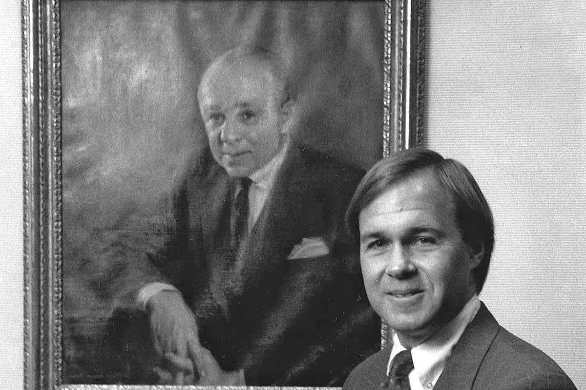 Winthrop Smith Jr. at Merrill Lynch with a portrait of his father, one of the company's co-founders
