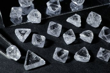 A selection of rough diamonds, produced by De Beers, is seen in this undated handout photo released to the media on Friday, Nov. 4, 2011. Anglo American Plc agreed to buy the Oppenheimer family's 40 percent stake in De Beers for $5.1 billion in cash, ending the dynasty's 80-year ownership in the world's largest diamond miner. Source: De Beers Group via Bloomberg EDITOR'S NOTE: NO SALES. EDITORIAL USE ONLY