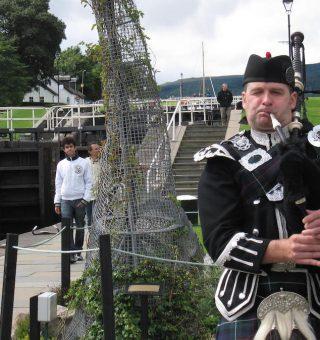 Spud the Bagpiper in Scotland