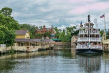 The Liberty Bell Riverboat with the Haunted Mansion in the backgroung