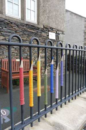 Knitted pencils on school railings