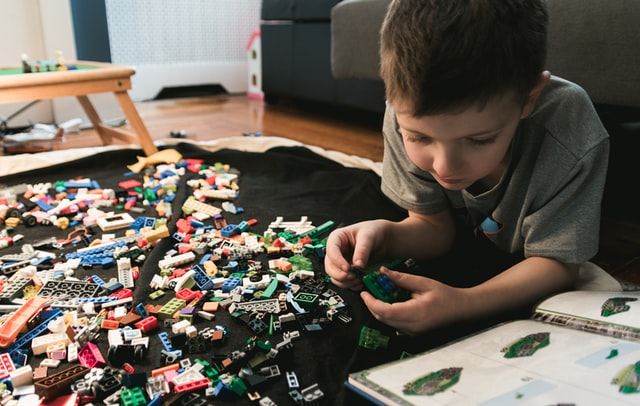 Child playing with LEGOs.
