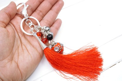 red beaded bag charm