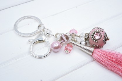 a pink indonesian beaded bag charm