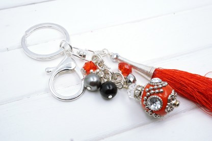 a red indonesian bead bag charm