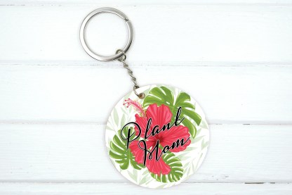 Plant mom keychain with hibiscus and monstera leaves