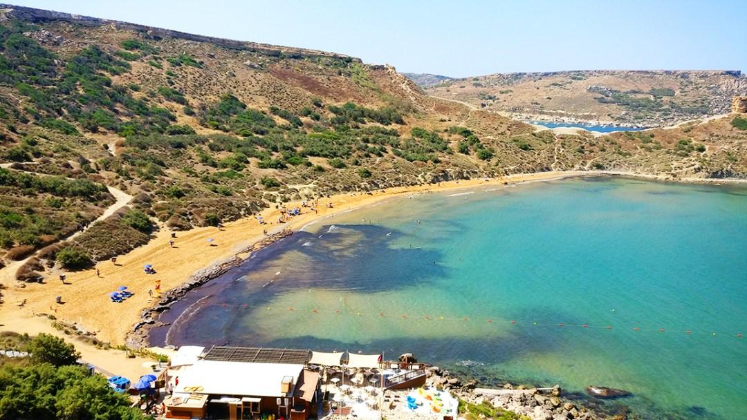Ghajn Tuffieha bay with reddish sand - Best beaches in Malta | Aliz's Wonderland