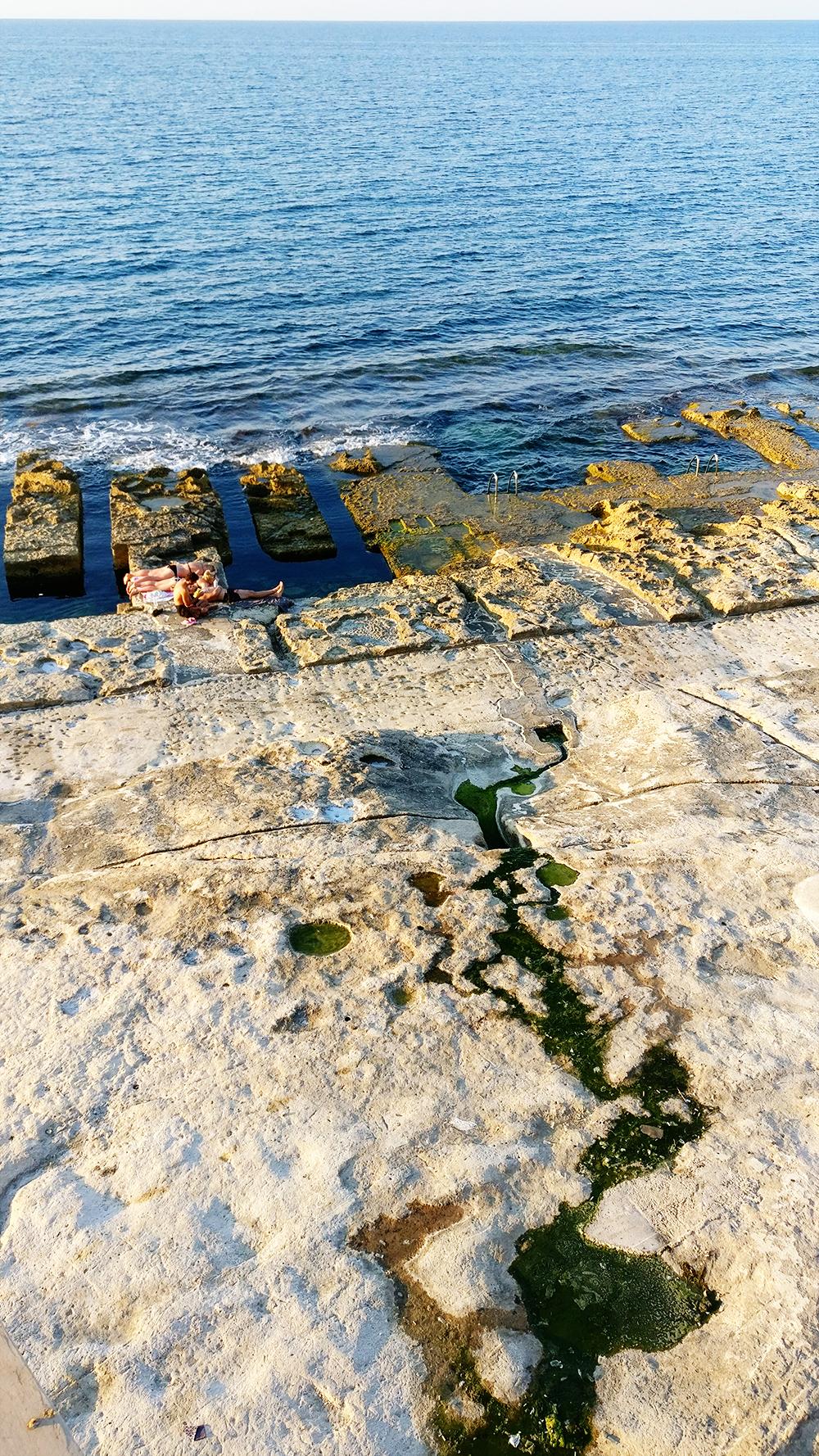 The rocky Fond Ghadir beach with small square pools in Sliema - Best beaches in Malta | Aliz's Wonderland