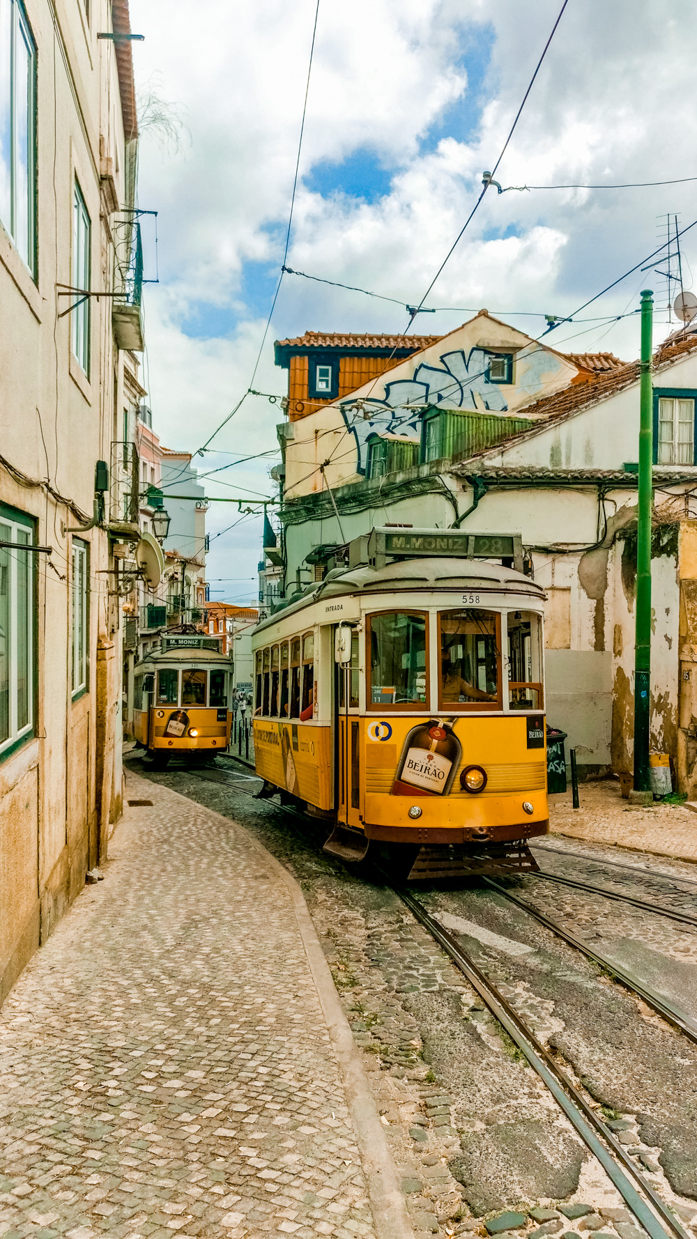 Tram 28 - Travel by vintage trams - 5 things you need to experience in Lisbon, Portugal | Aliz's Wonderland