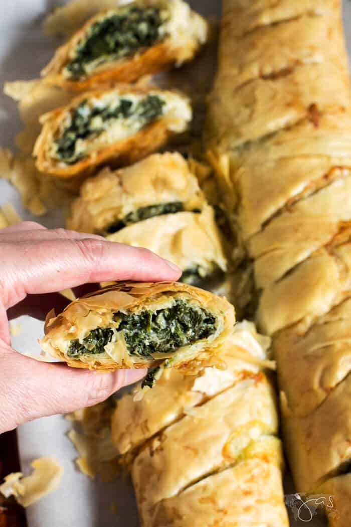 A piece of delicious, vegetarian phyllo pie with spinach and cheese