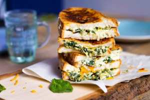 delicious crusty and gooey spinach artichoke grilled cheese