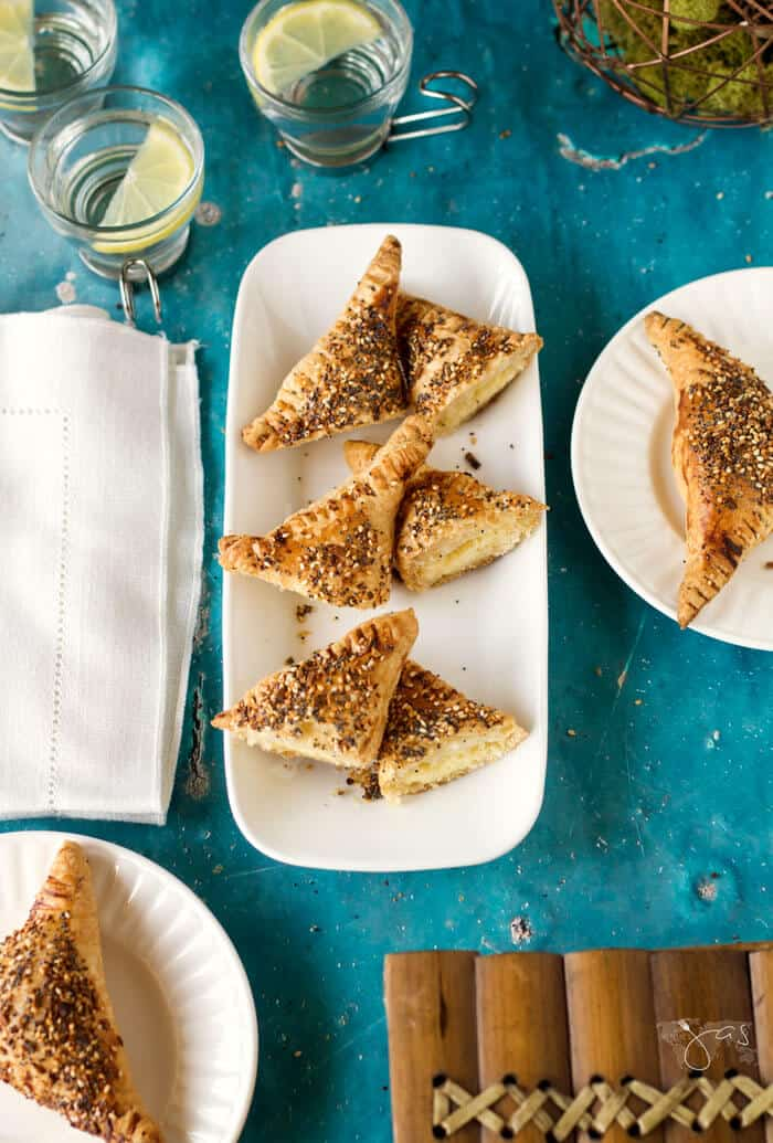These Israeli cheese borekas topped with everything bagel seasoning are perfect for parties, picnics, weekly practices and games, breakfast or brunch, and supper.